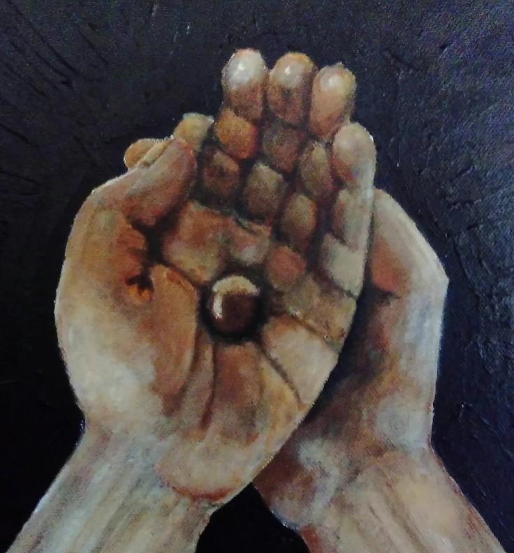 Hands holding a hazel nut